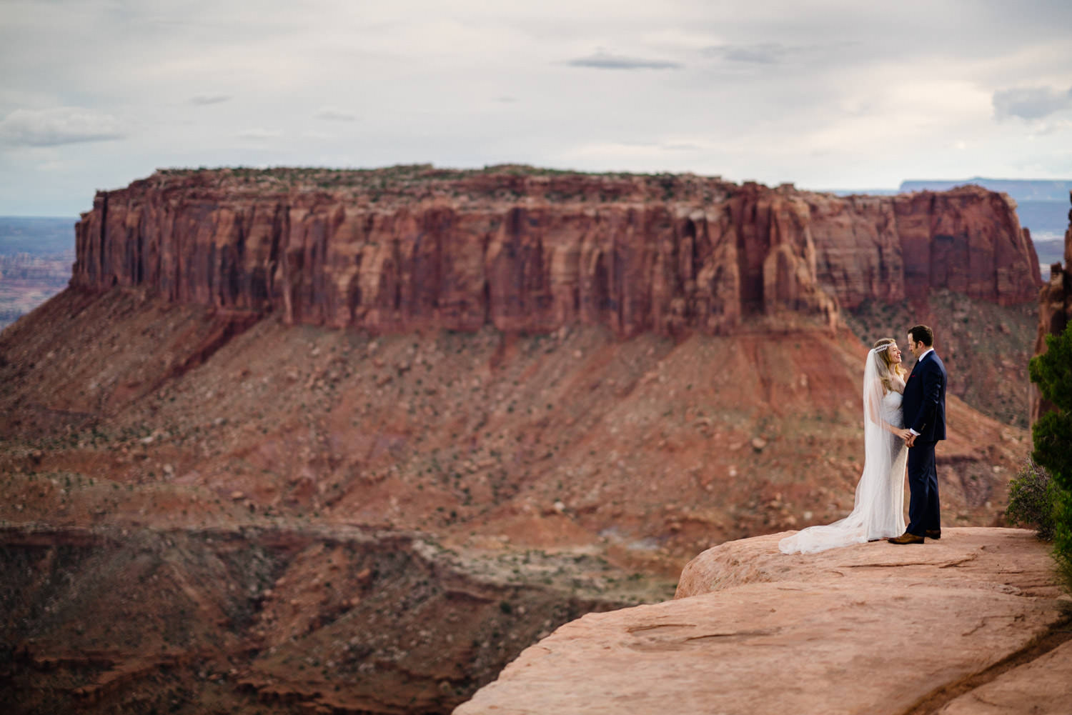 Canyonlands National Park Wedding bride and groom embracing photo