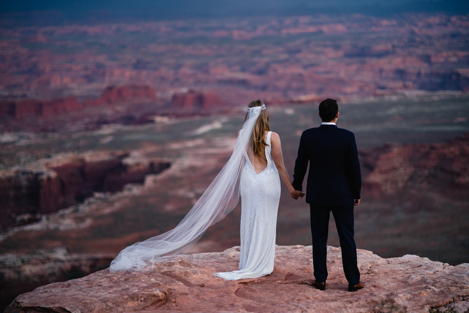 Canyonlands Wedding newlyweds holding hands photo