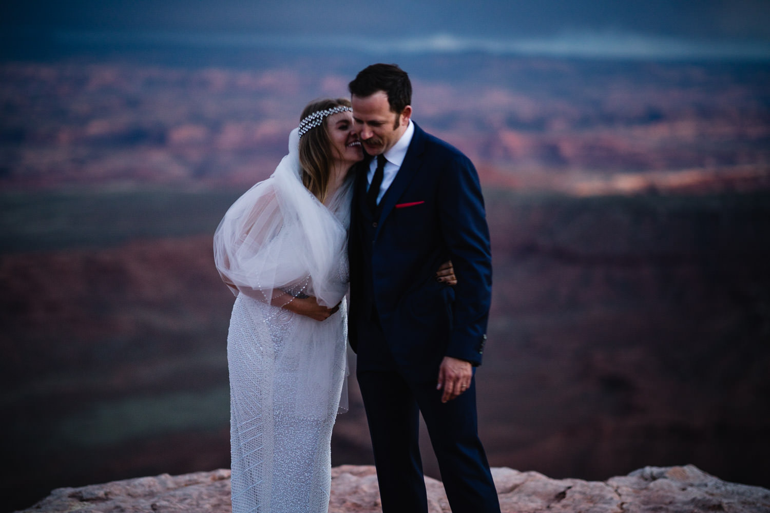 Canyonlands National Park Wedding bride laughing and holding her veil photo