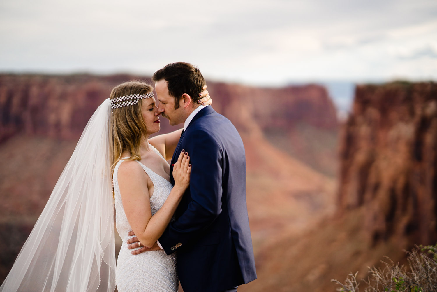 Canyonlands National Park Wedding bride and groom leaning in to kiss photo