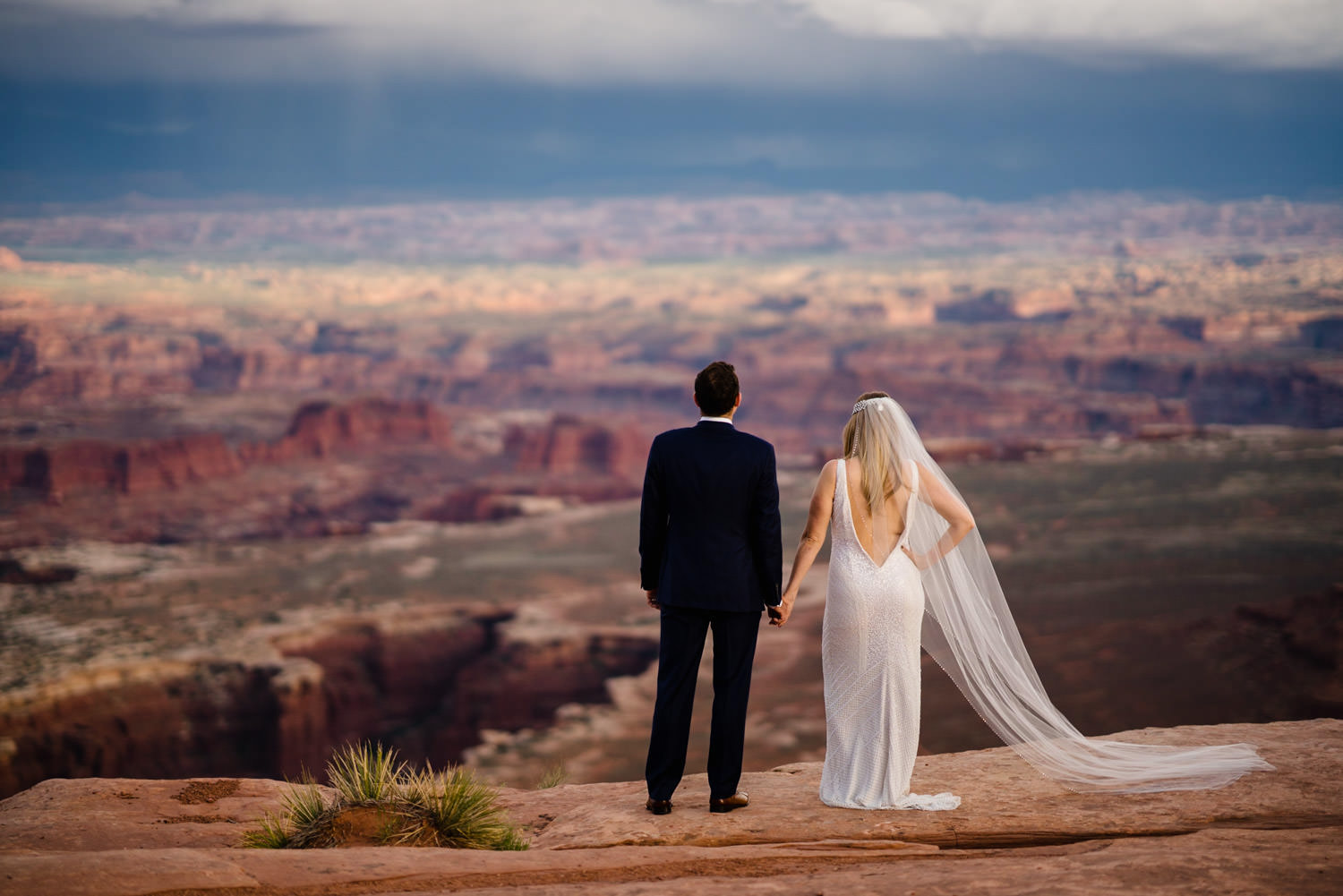 Canyonlands National Park Wedding bride and groom holding hands photo