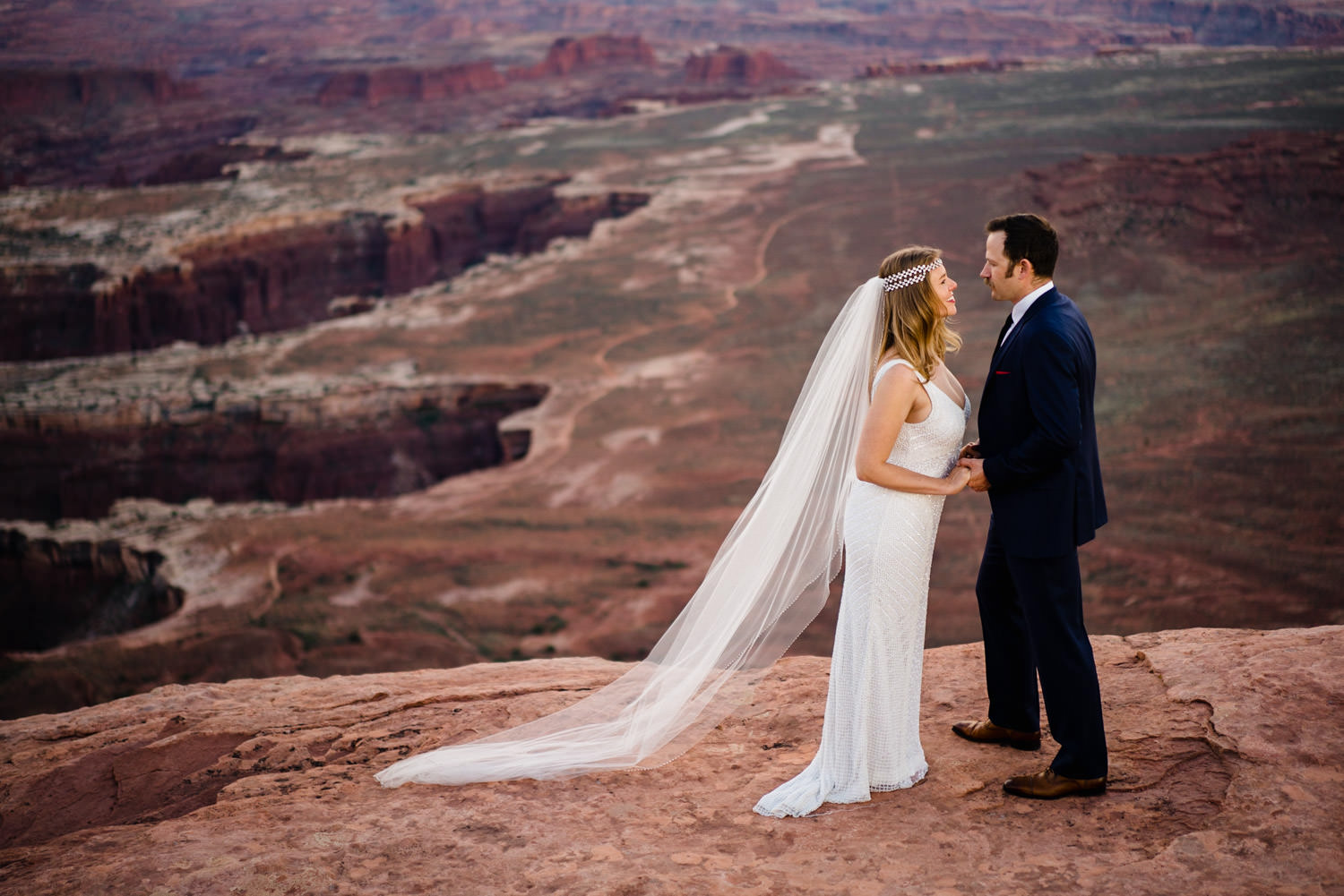 Canyonlands National Park Wedding bride and groom laughing photo