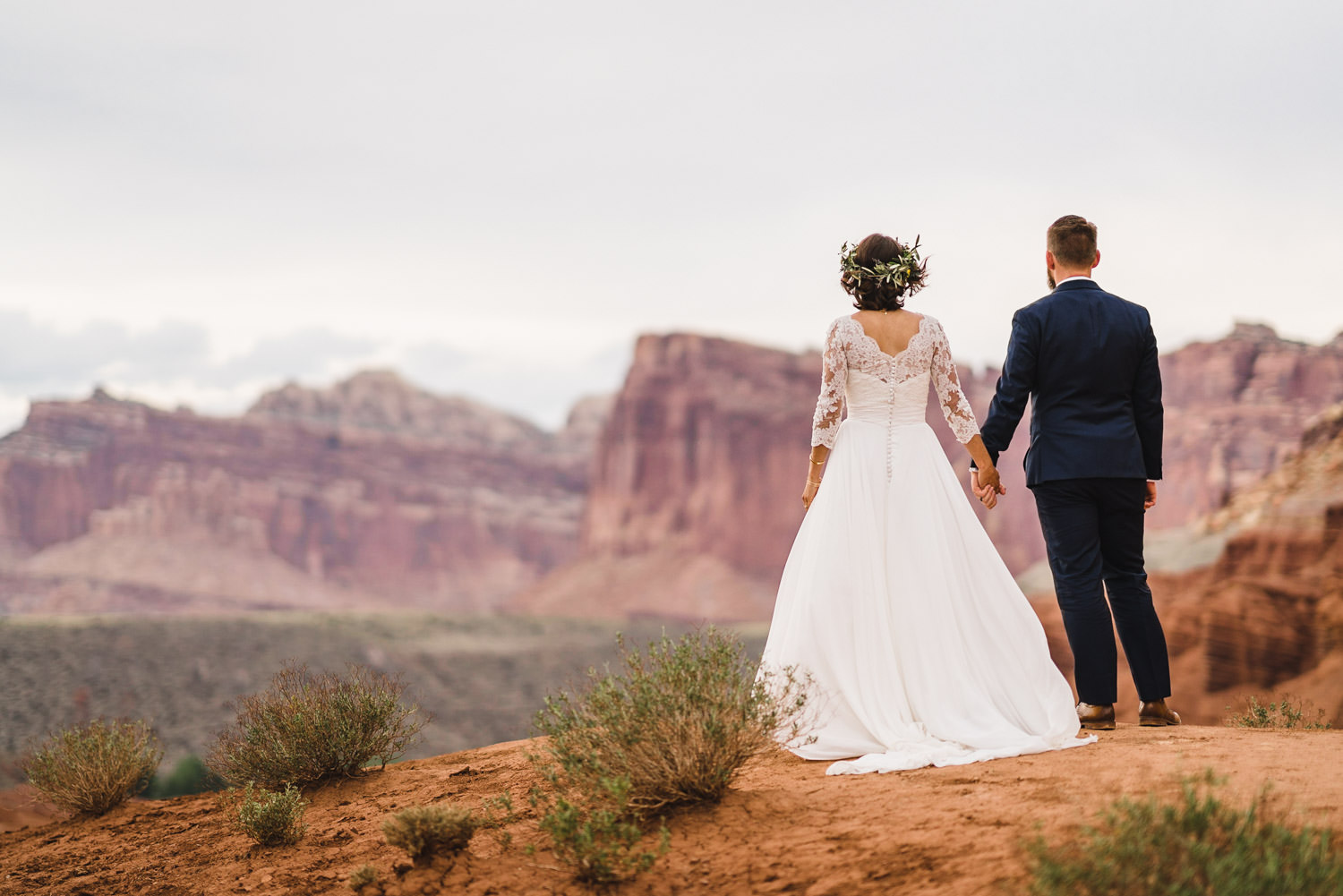Capitol Reef National Park Wedding bride and groom holding hands photo