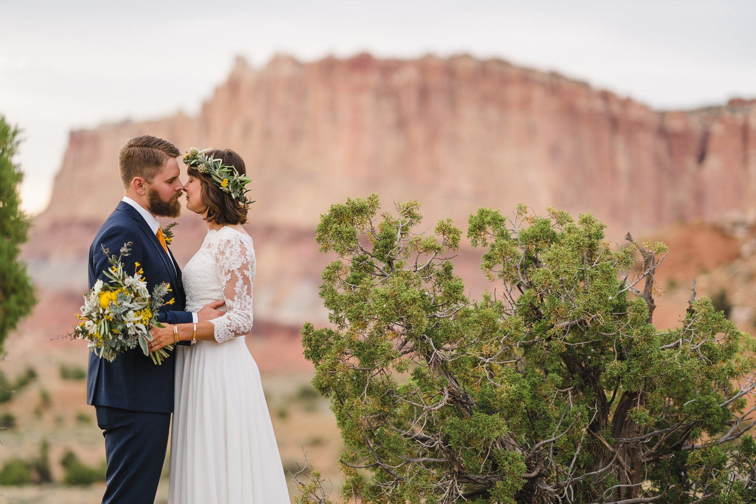 Capitol Reef National Park Wedding bride and groom leaning in to kiss photo