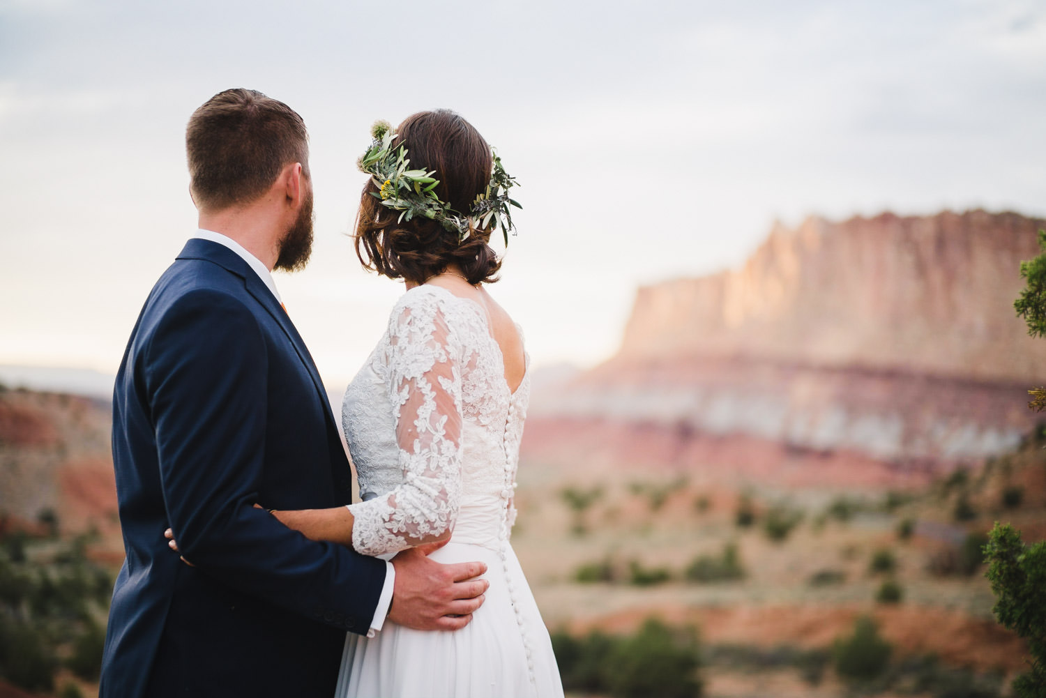 Capitol Reef National Park Wedding bride and groom hugging photo