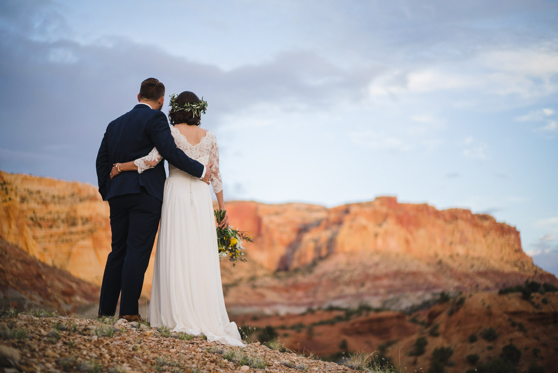 Capitol Reef National Park Wedding newlyweds embracing photo