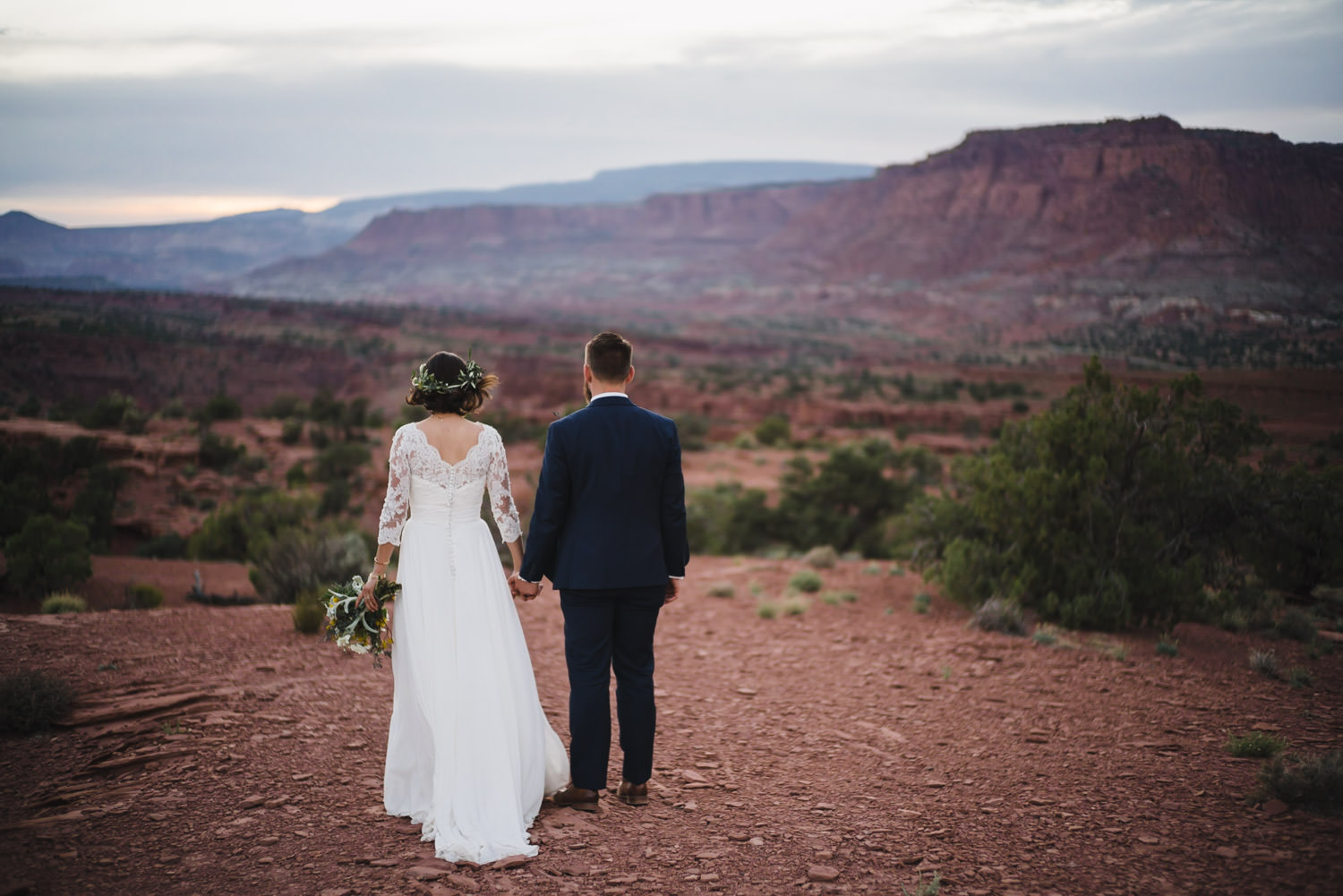 Capitol Reef Wedding newlyweds holding hands photo