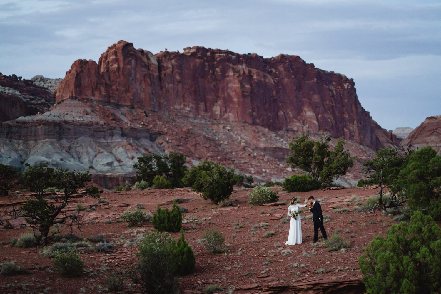 Capitol Reef National Park Wedding groom kissing the bride's hand photo