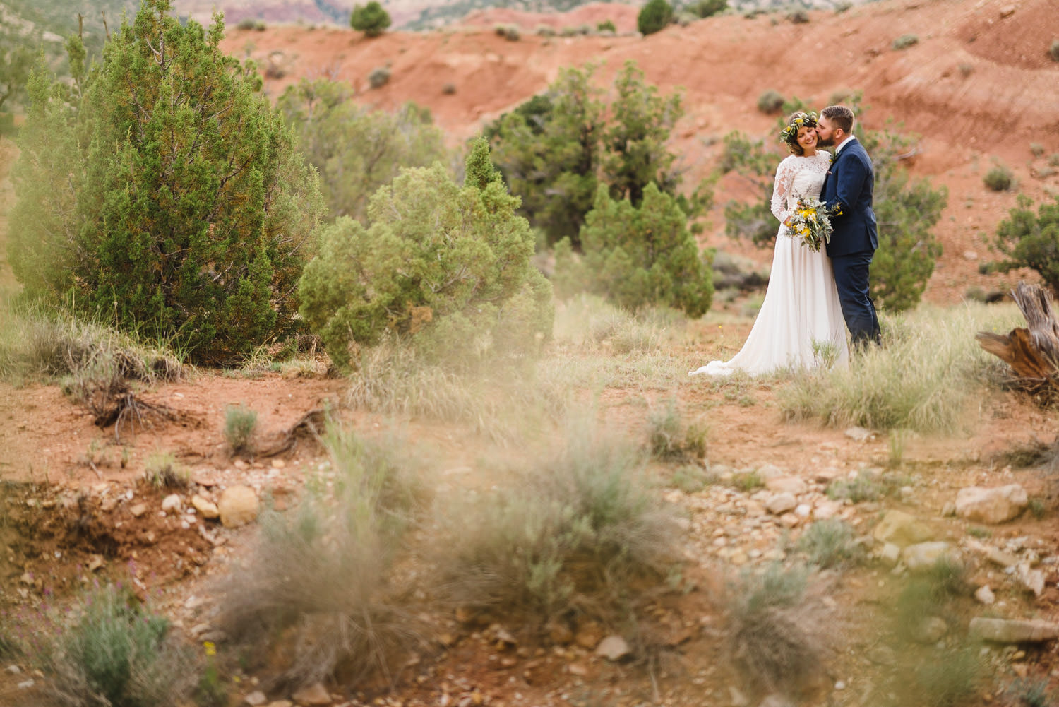 Capitol Reef National Park Wedding groom kissing the bride's cheek photo