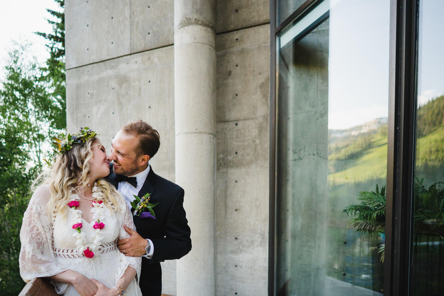 Wedding at Snowbird Cliff Lodge couple kissing outside of the Cliff Lodge photo