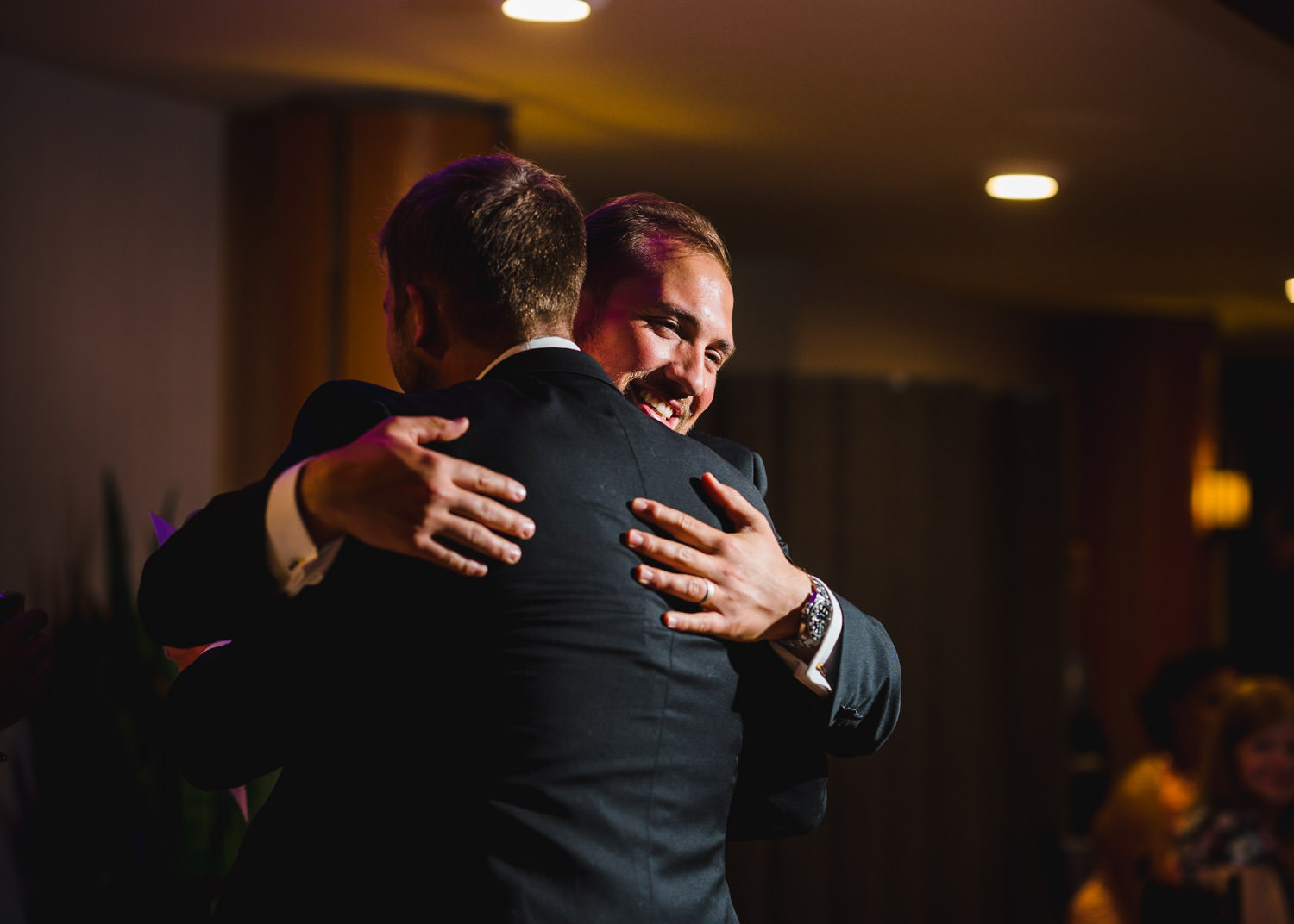 Wedding at Snowbird Cliff Lodge groom hugging guest photo