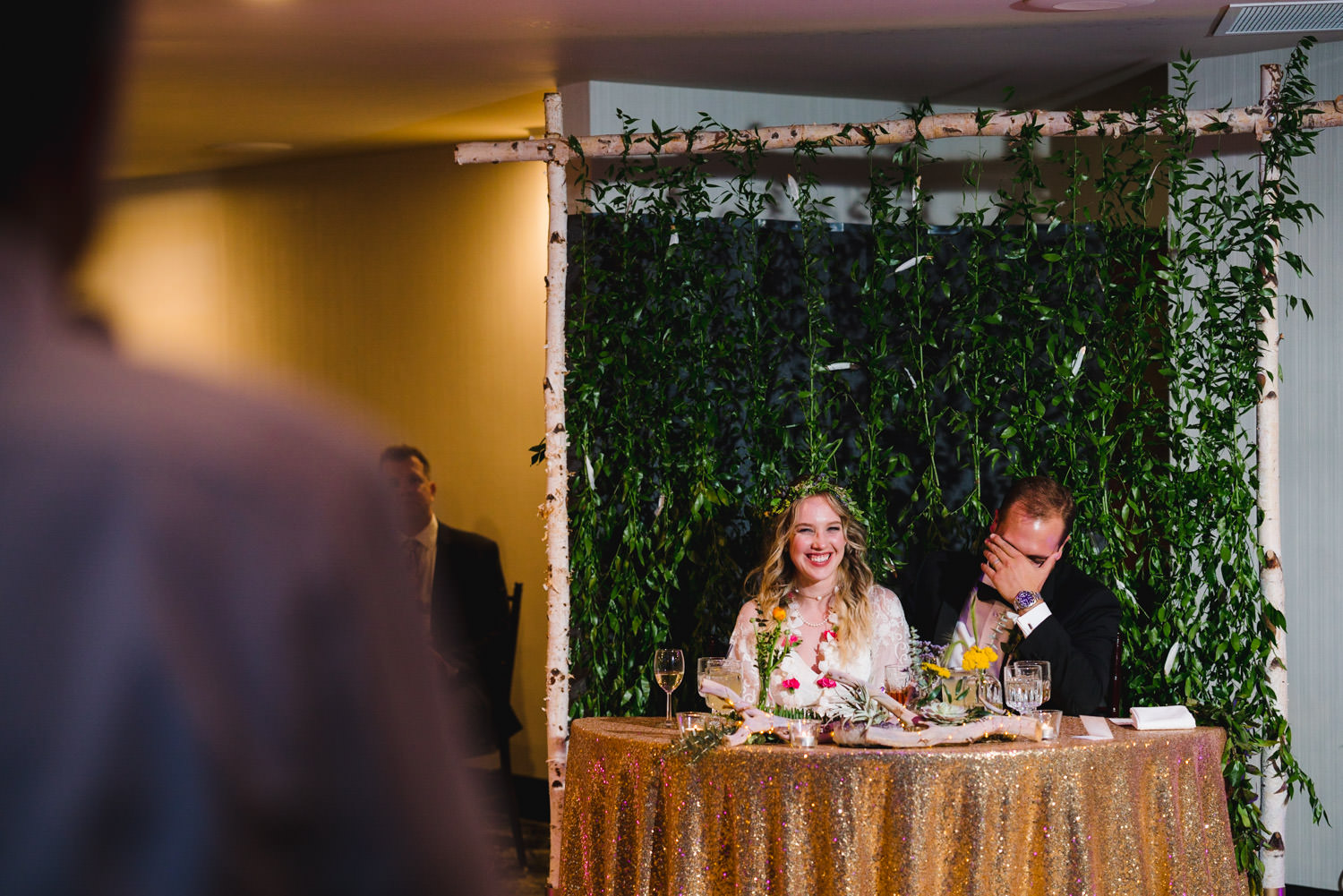 Wedding at Snowbird Cliff Lodge couple laughing at head table during reception photo
