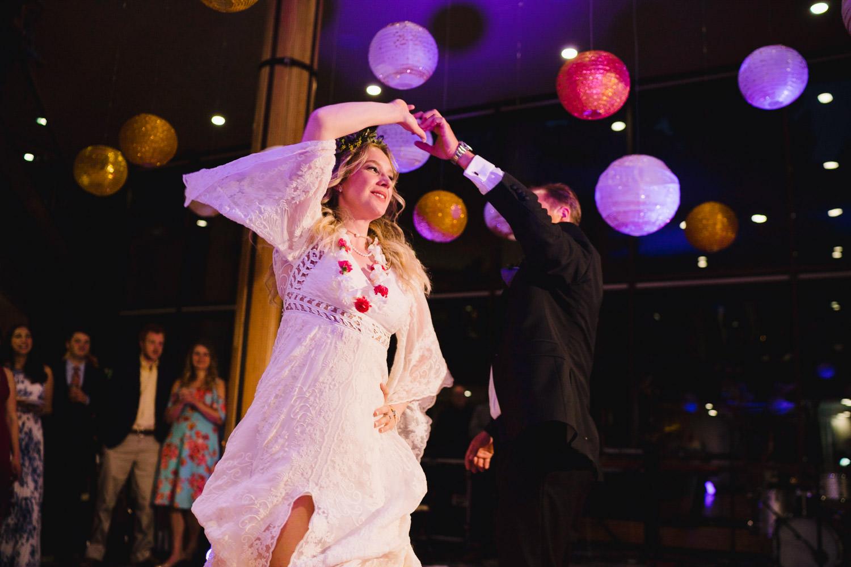 Wedding at Snowbird Cliff Lodge bride dancing under paper lanterns photo