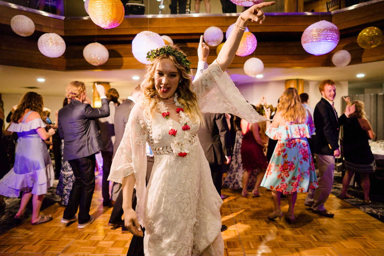 Wedding at Snowbird Cliff Lodge bride having fun while dancing photo