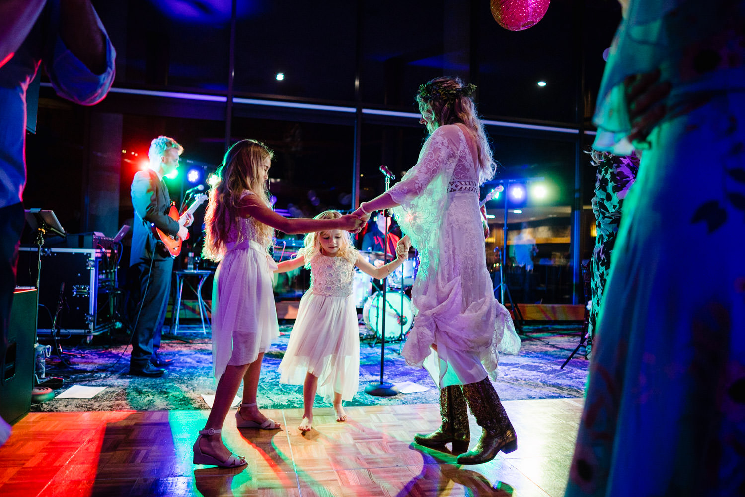 Wedding at Snowbird Cliff Lodge bride dancing with young guests photo