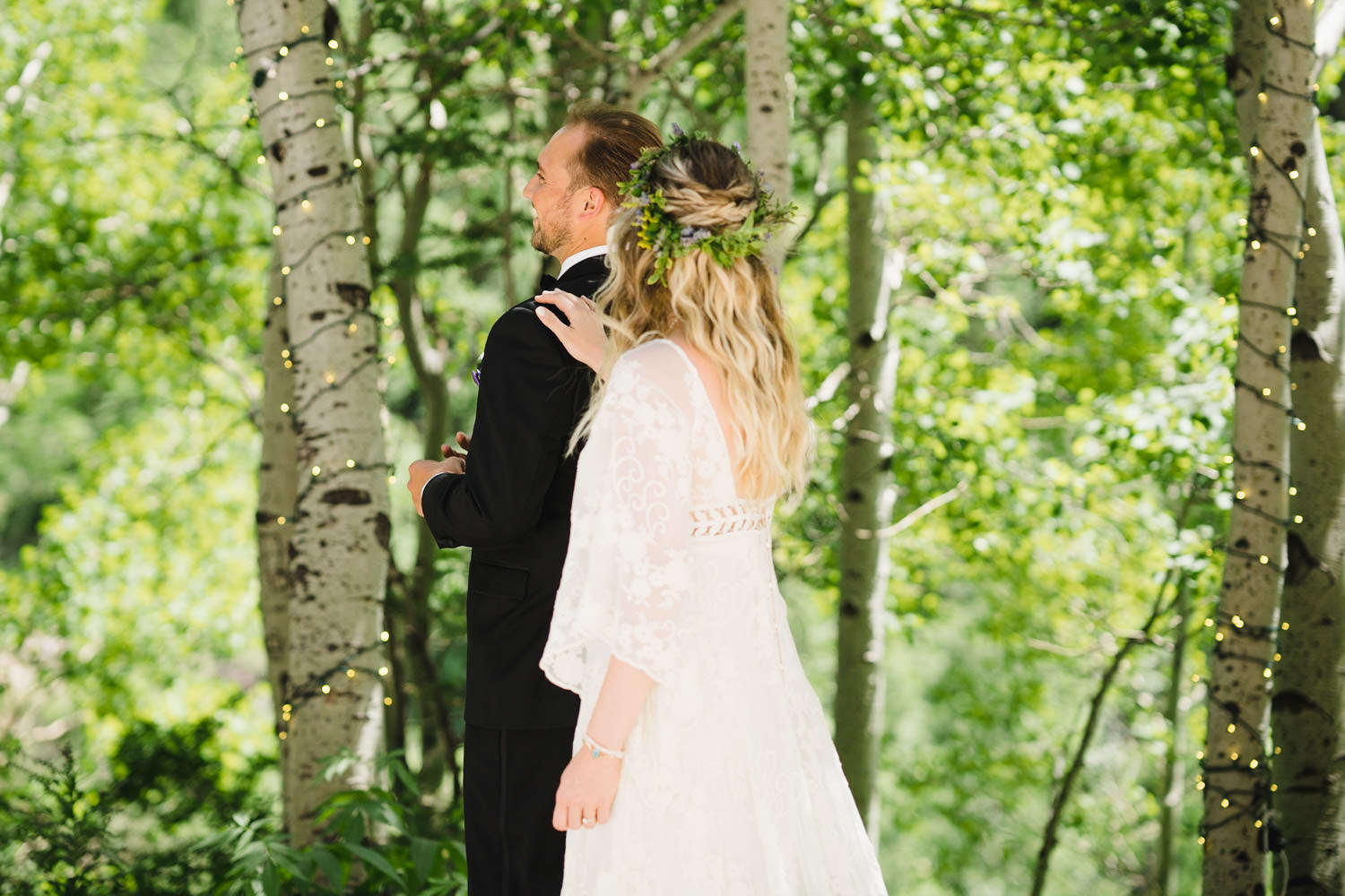 Wedding at Snowbird Cliff Lodge bride tapping groom for first look photo