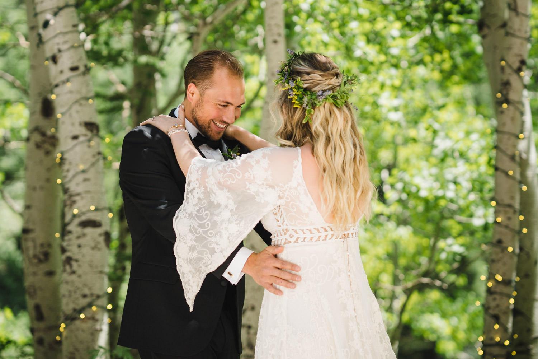 Wedding at Snowbird Cliff Lodge enjoying first look photo