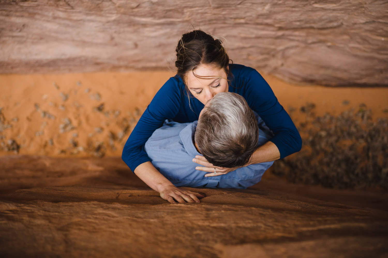 Arches engagement couple kissing in slot canyons photo