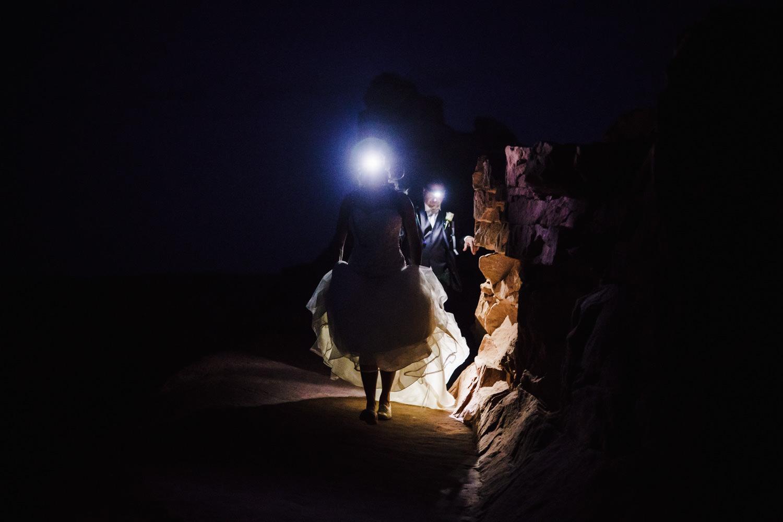 Night sky wedding bride with headlamp photo