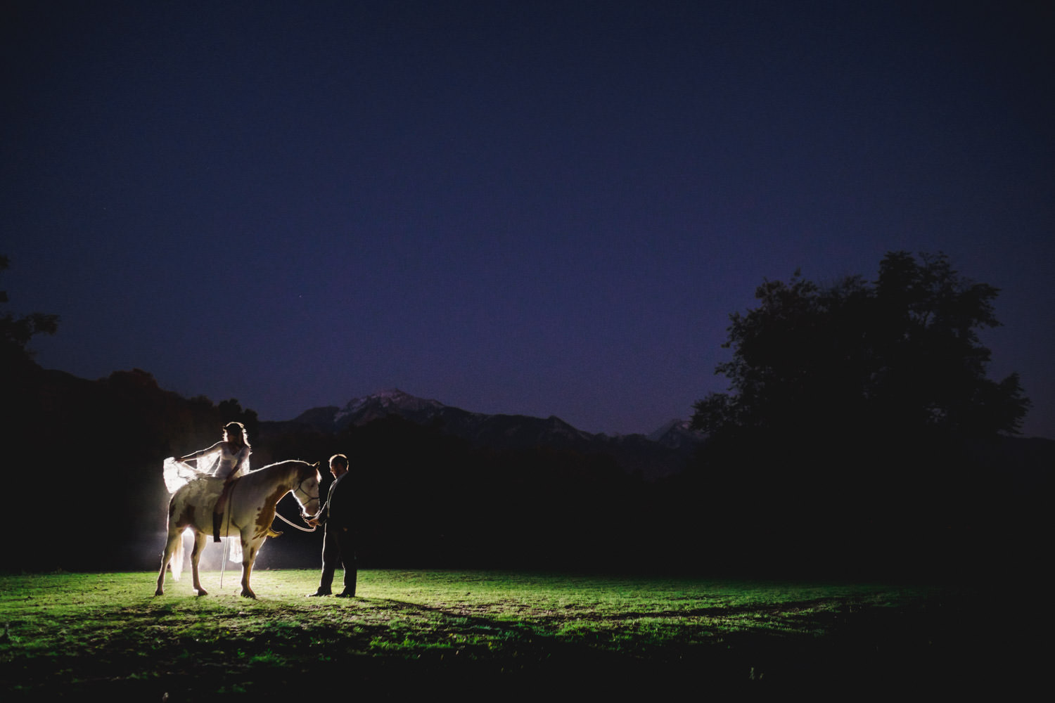 Equestrian bridal session bride on horse in the evening photo