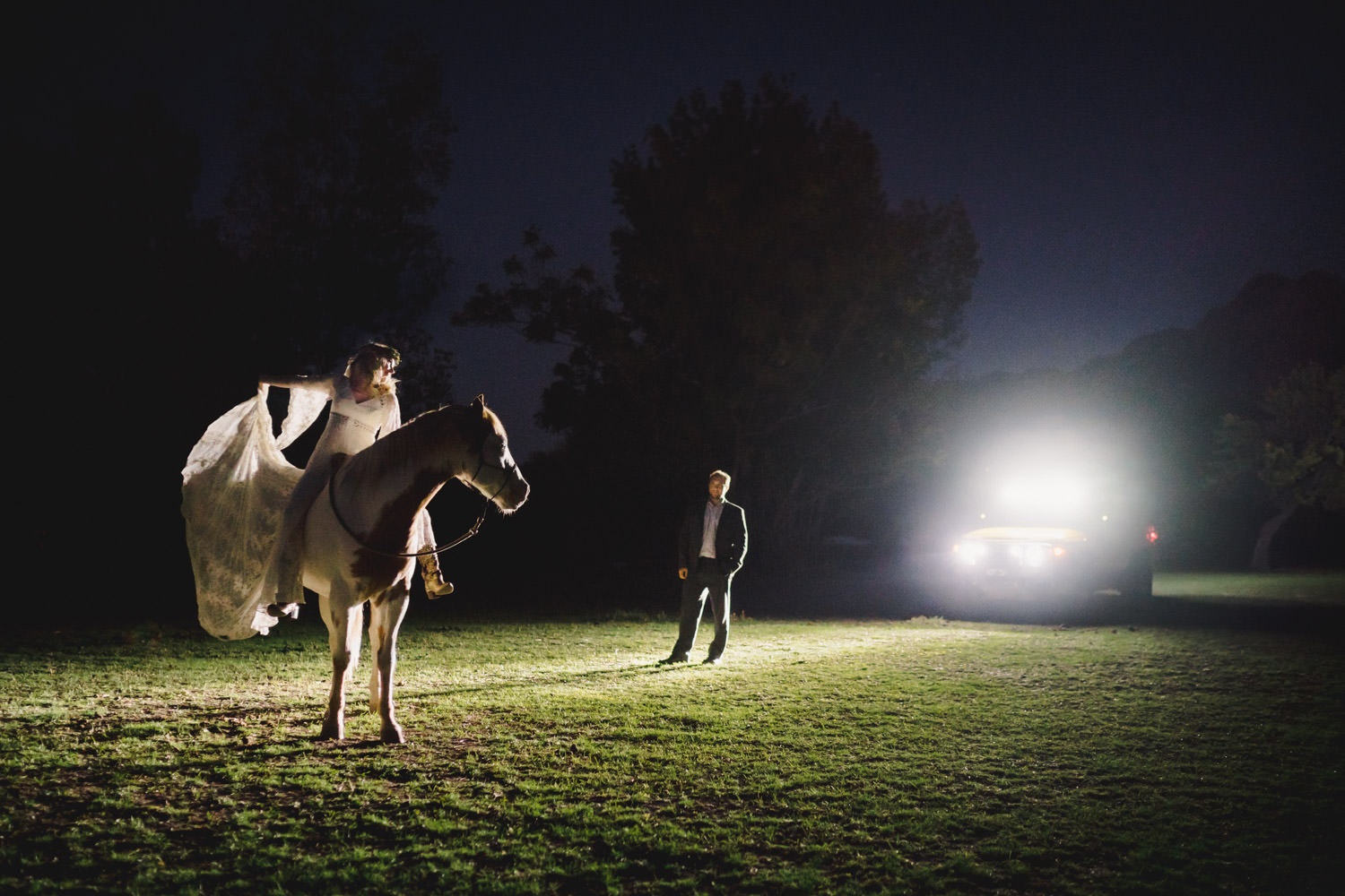 Equestrian bridal session bride, groom, horse and car with headlights photo