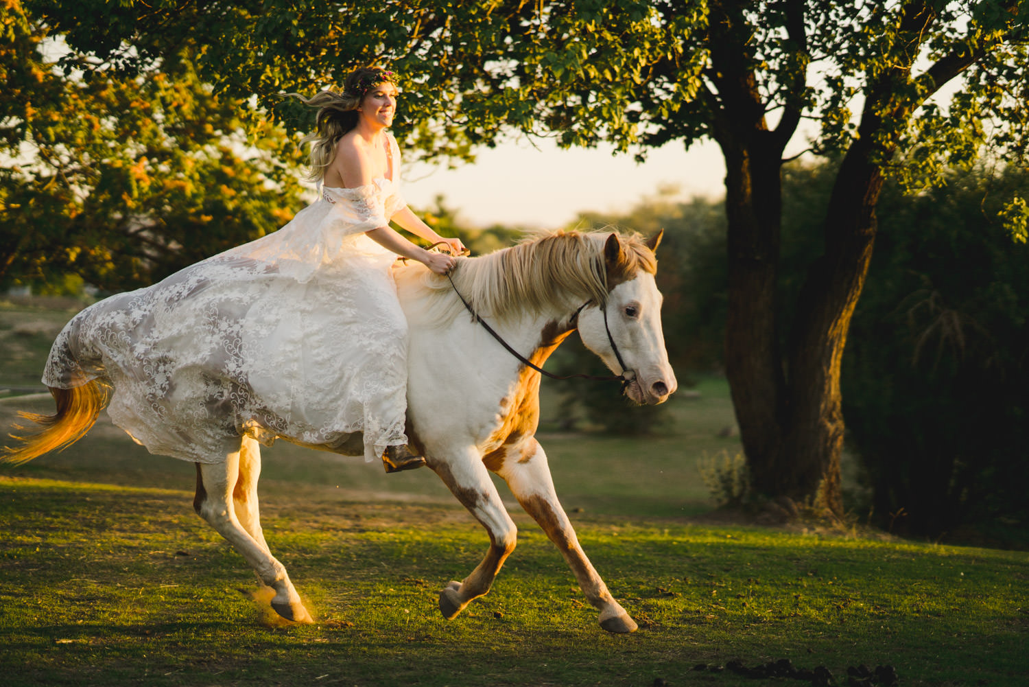 Equestrian bridal session horse galloping with bride in gown photo