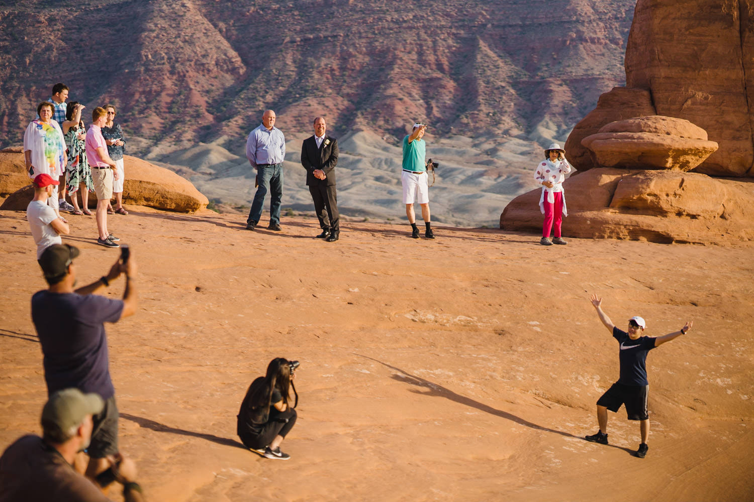 Delicate Arch elopement guests and landscape photo