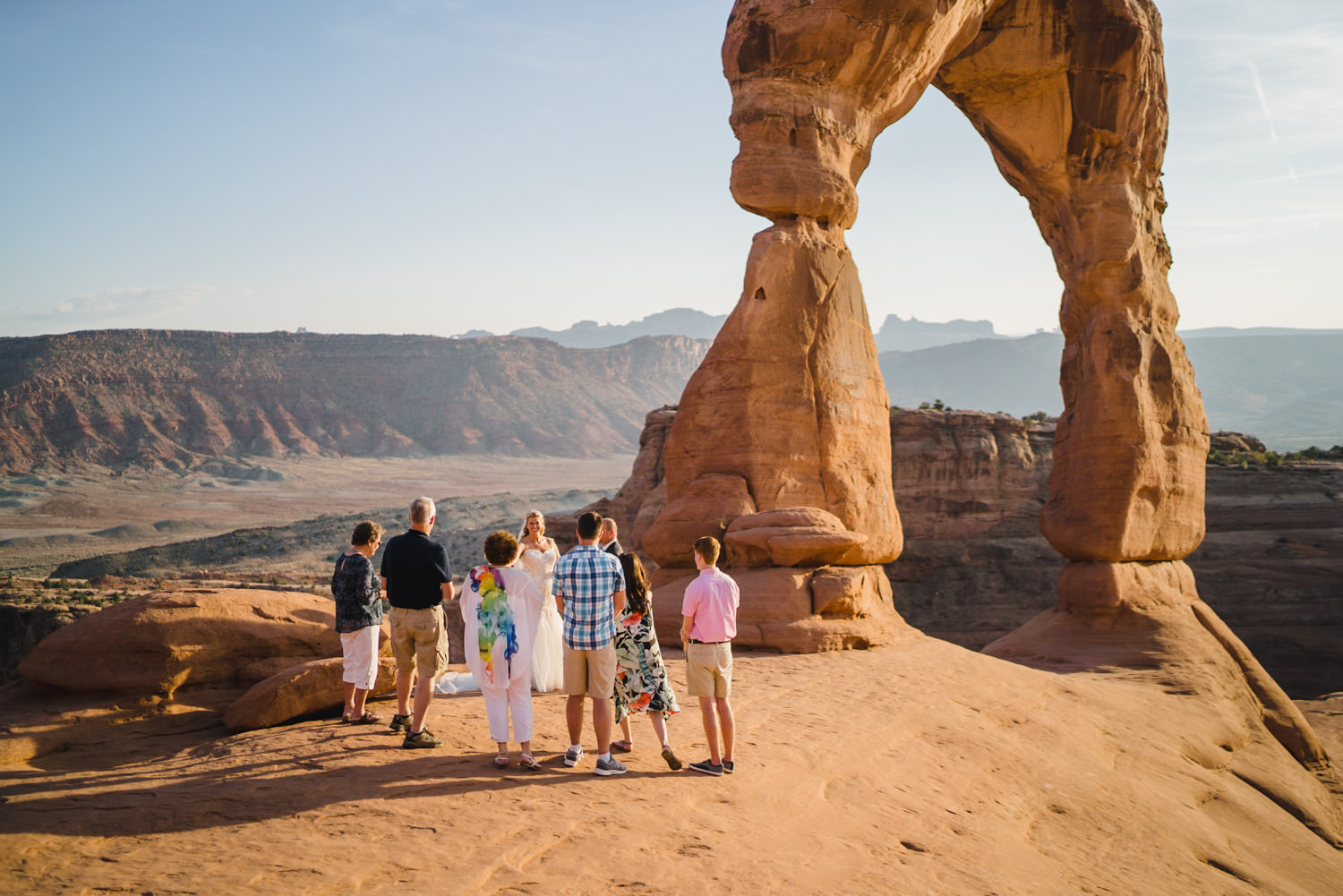 Delicate Arch elopement guests gathered photo