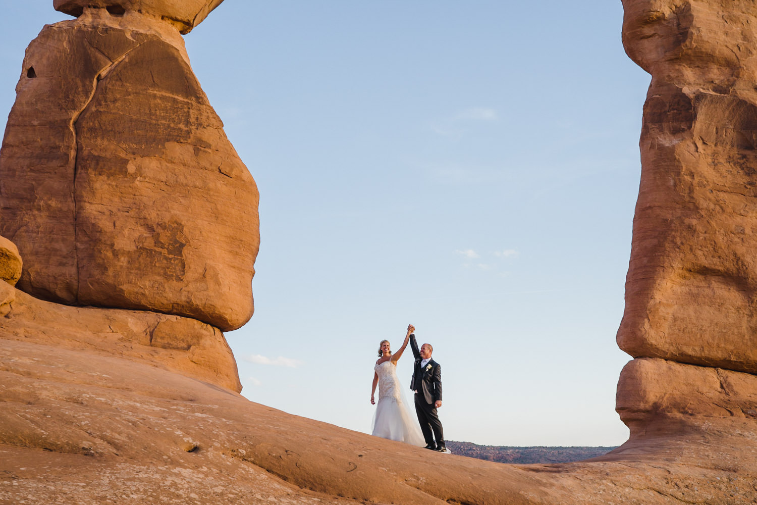 Delicate Arch elopement couple in Arches National Park photo