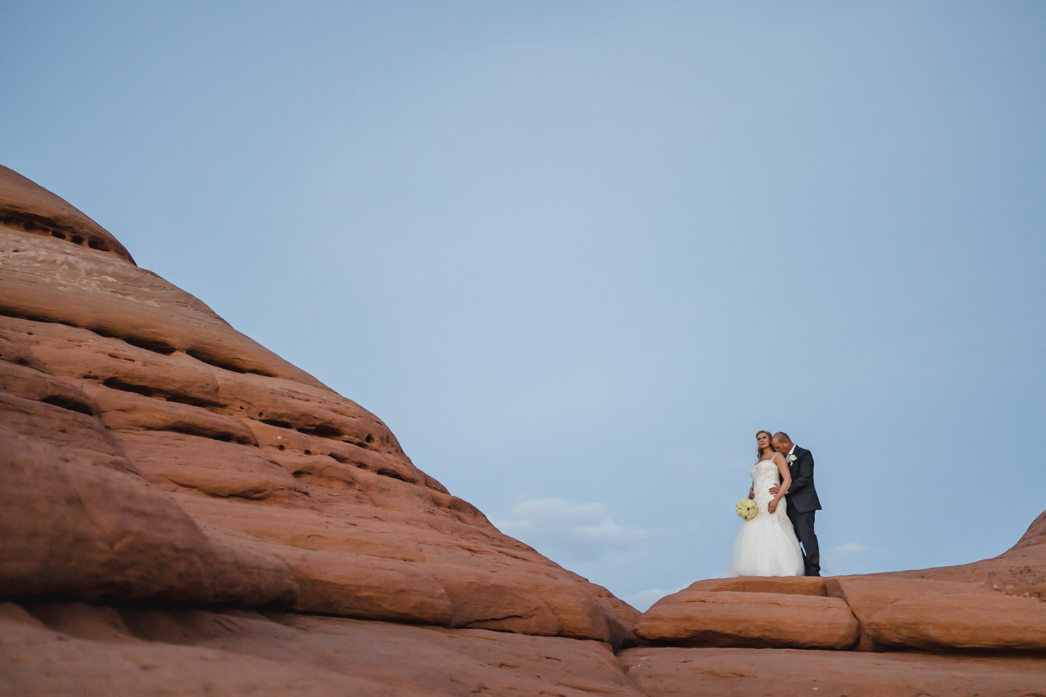 Delicate Arch elopement bride and groom portrait photo