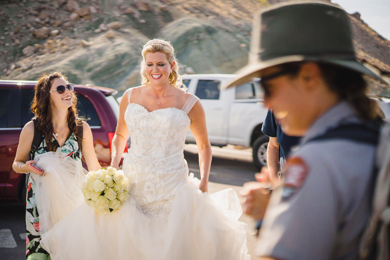Delicate Arch elopement bride arriving to Arches National Park photo