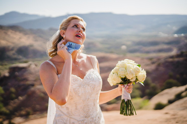 Delicate Arch elopement bride with bridal bouquet photo