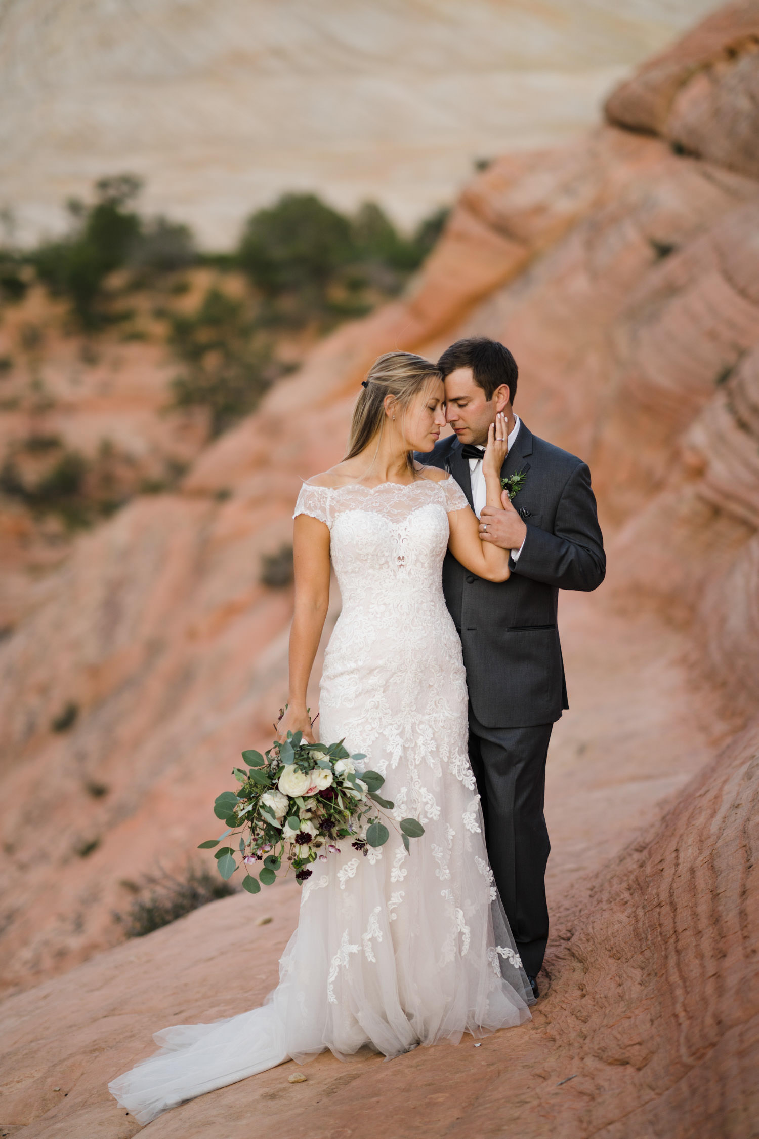 Zion National Park wedding bride and groom outside with bridal bouquet photo