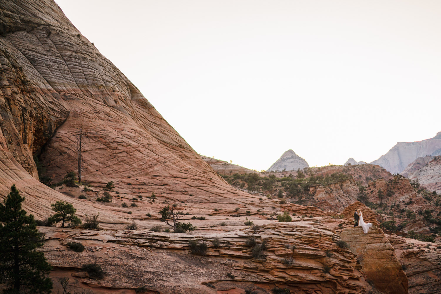 Zion National Park wedding rocky landscape with couple on rock perch photo