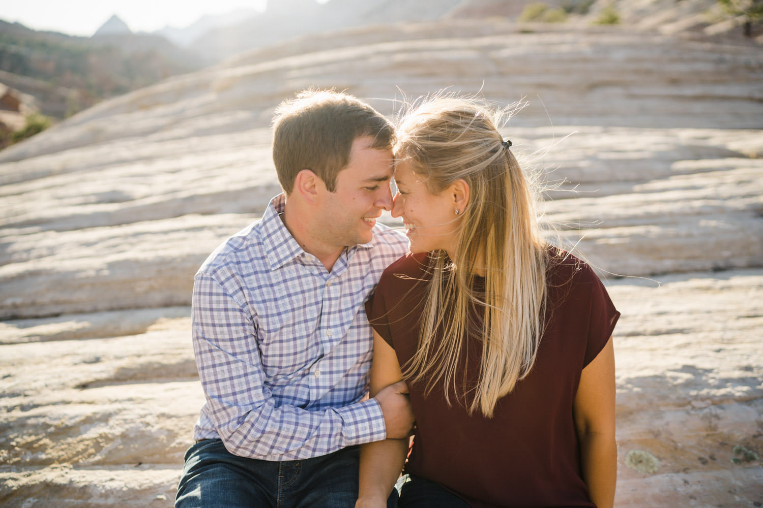 Zion National Park wedding couple close together on large rock photo