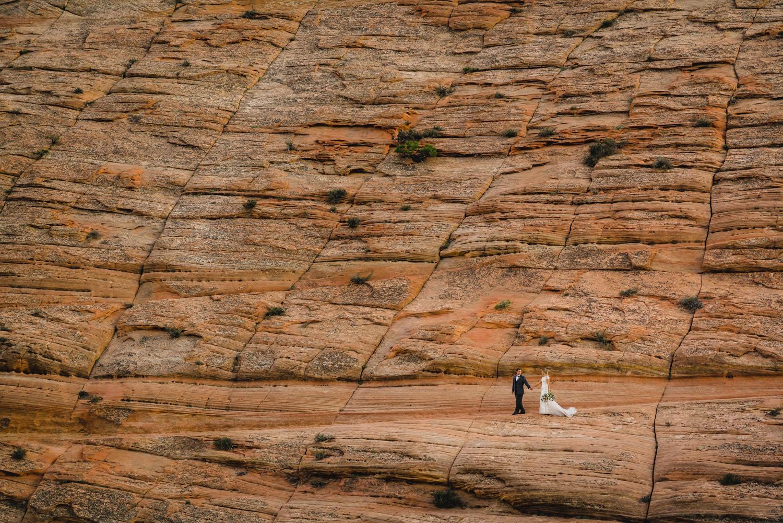 Zion National Park wedding couple walking trail through red rocks photo