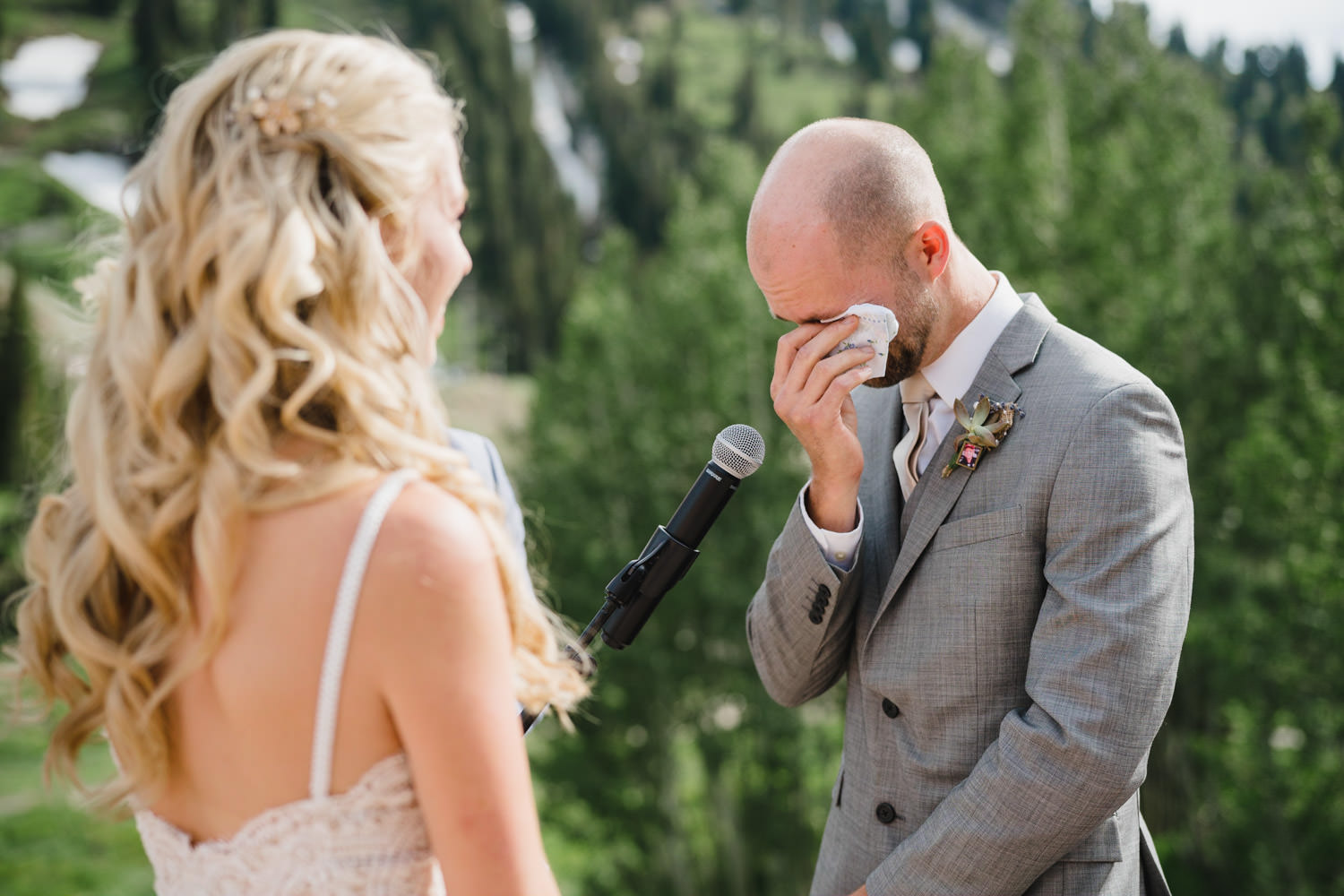 Alta Lodge wedding groom wiping tears during the ceremony photo