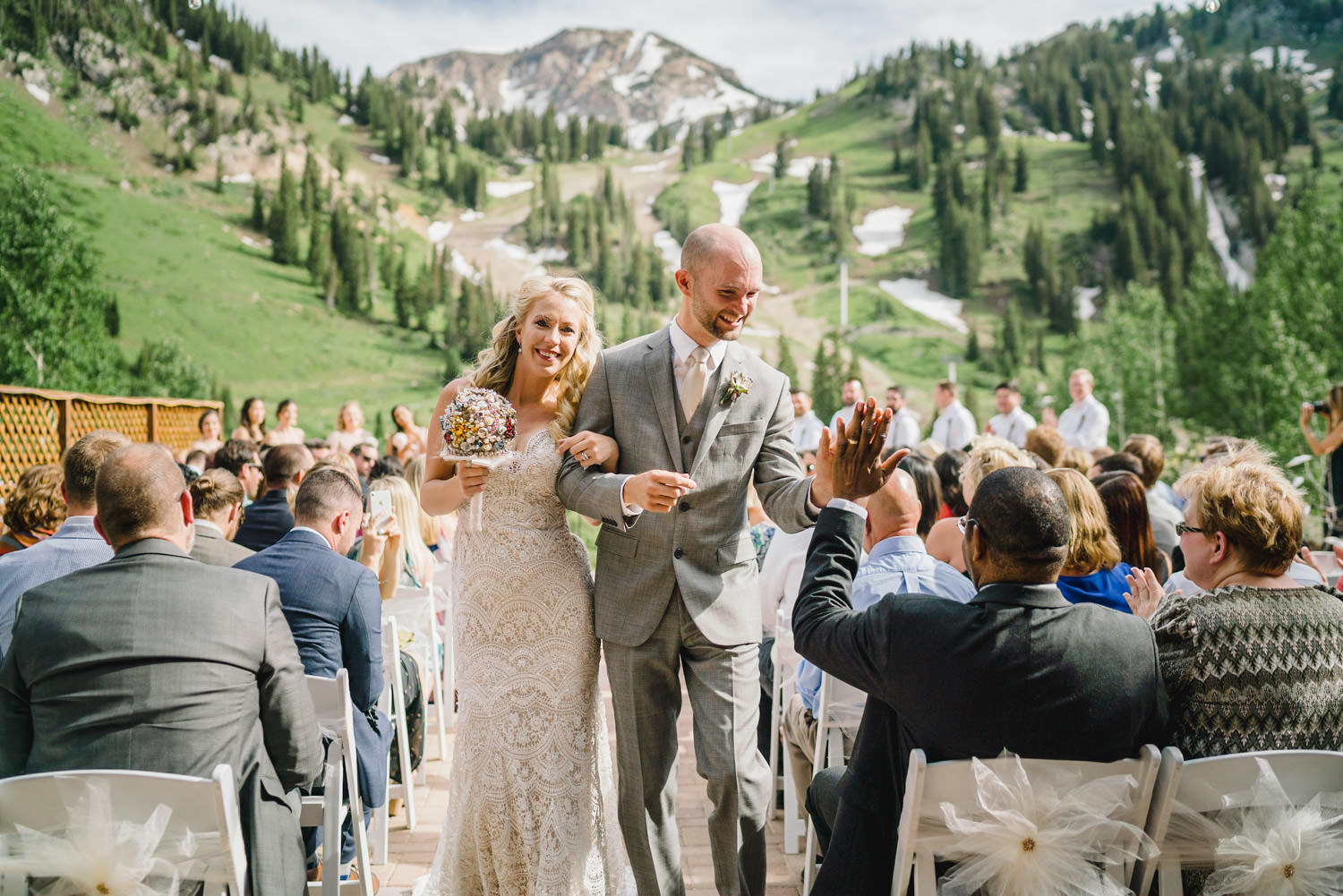 Alta Lodge wedding groom gives high five leaving ceremony photo