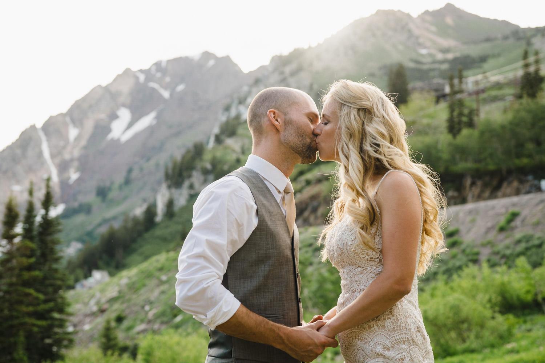 Alta Lodge wedding couple kissing in Little Cottonwood Canyon photo