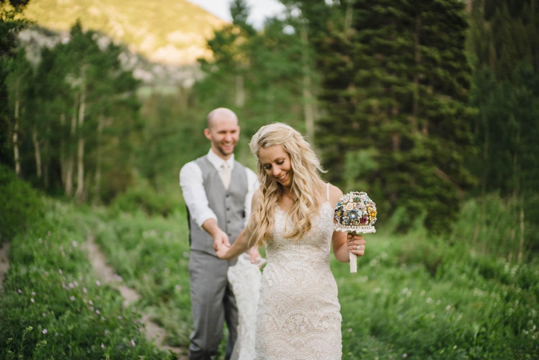 Alta Lodge wedding bride leading groom down path photo