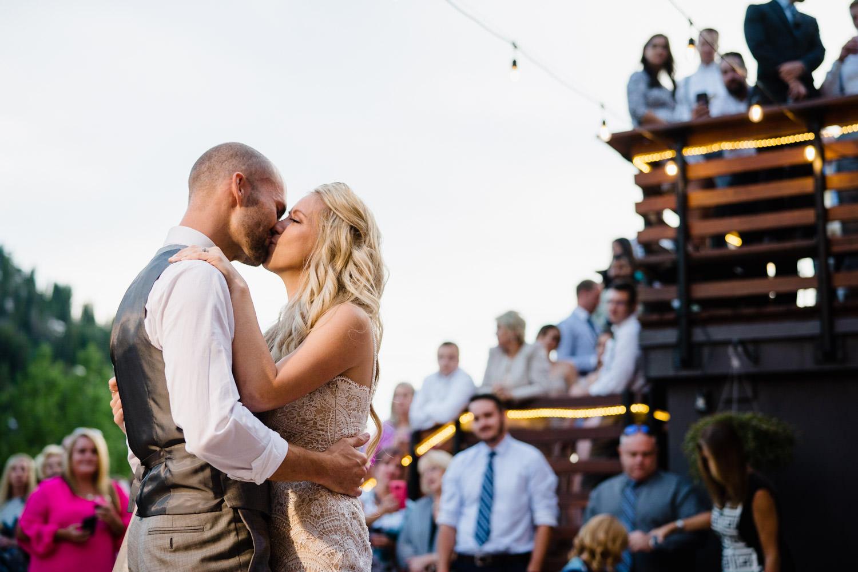 Alta Lodge wedding bride and groom dancing and kissing photo