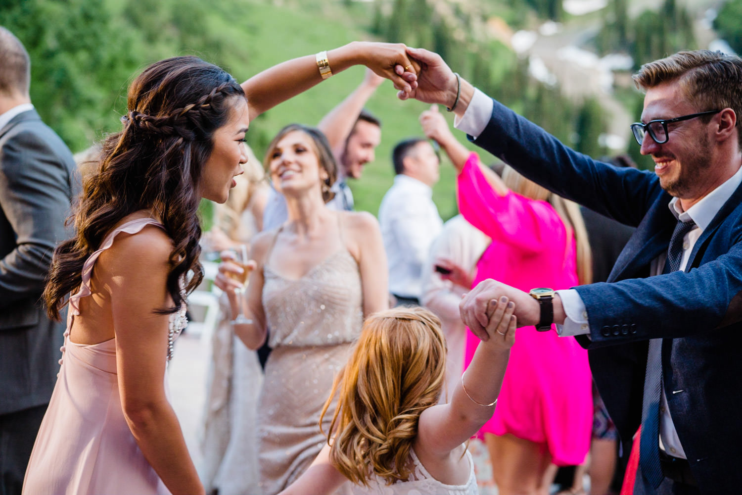Alta Lodge wedding guests dancing with young girl photo