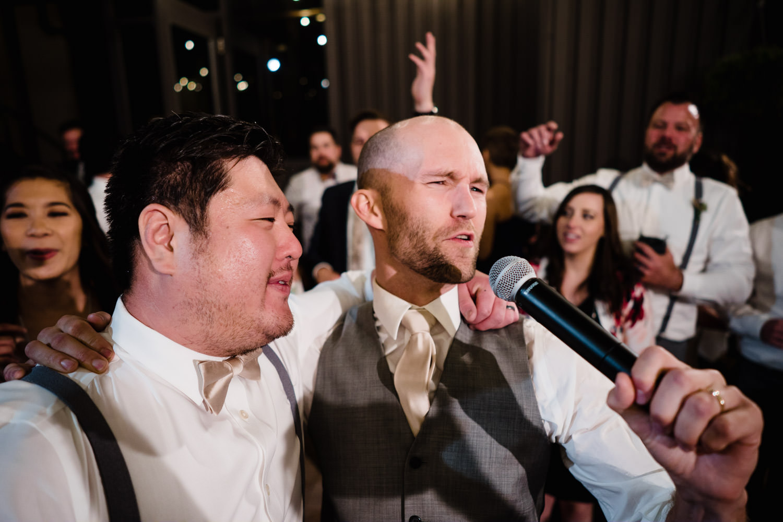 Alta Lodge wedding groom singing into microphone photo