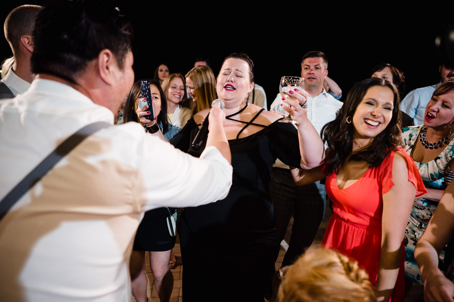 Alta Lodge wedding guests singing with microphone photo