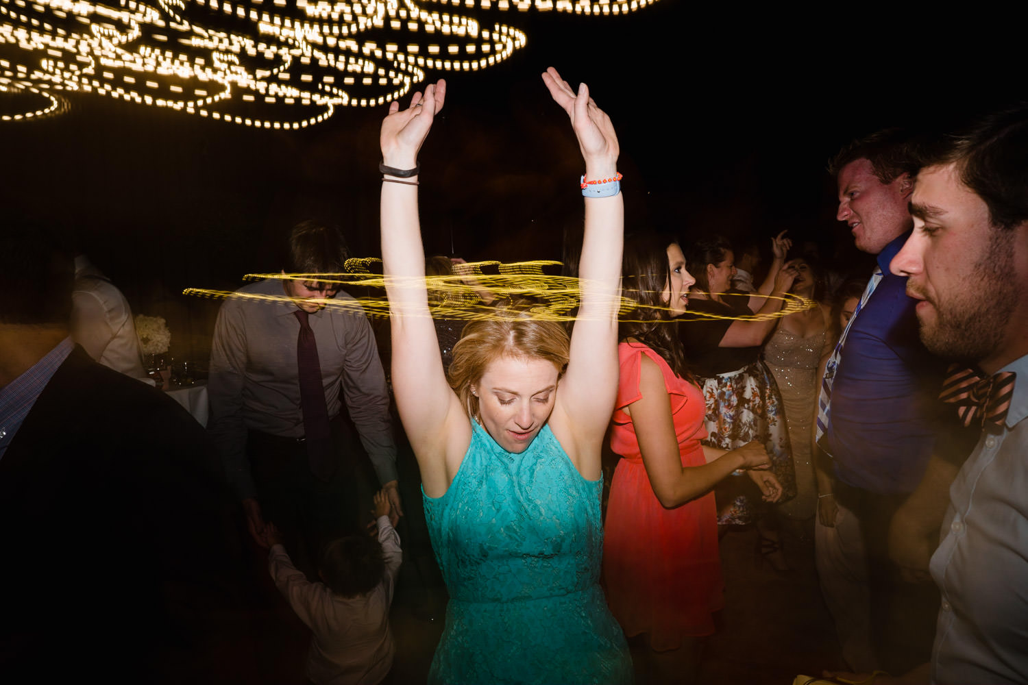 Alta Lodge wedding woman dancing with light painting photo
