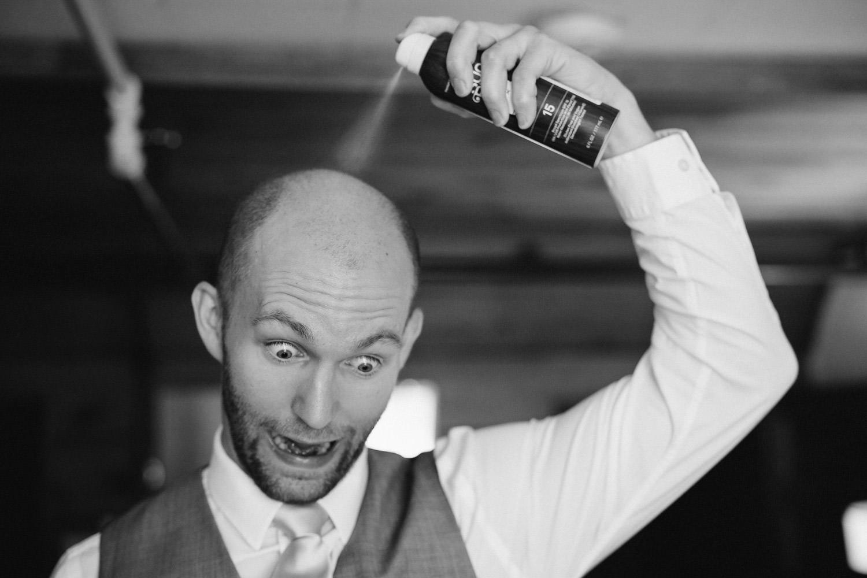 Alta Lodge wedding groom spraying hairspray photo