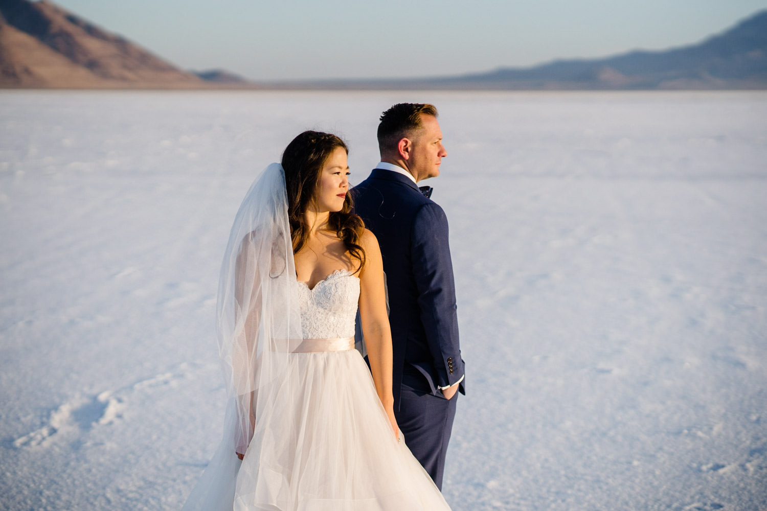Bonneville Salt Flats wedding bride and groom back to back portrait photo