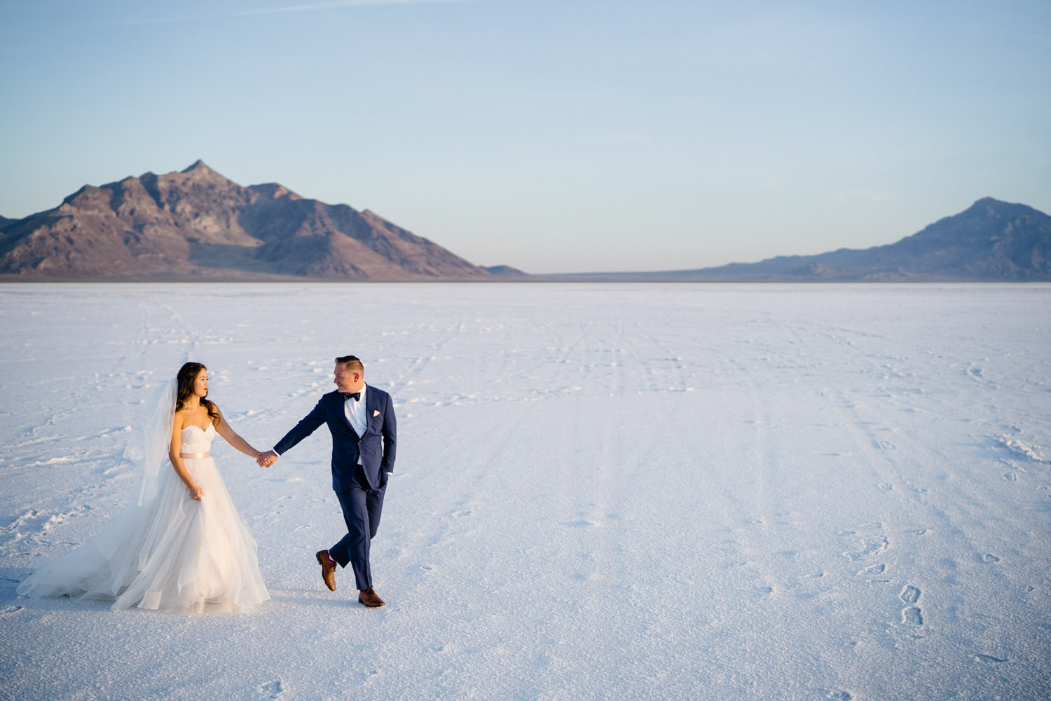 Bonneville Salt Flats wedding groom leading bride photo