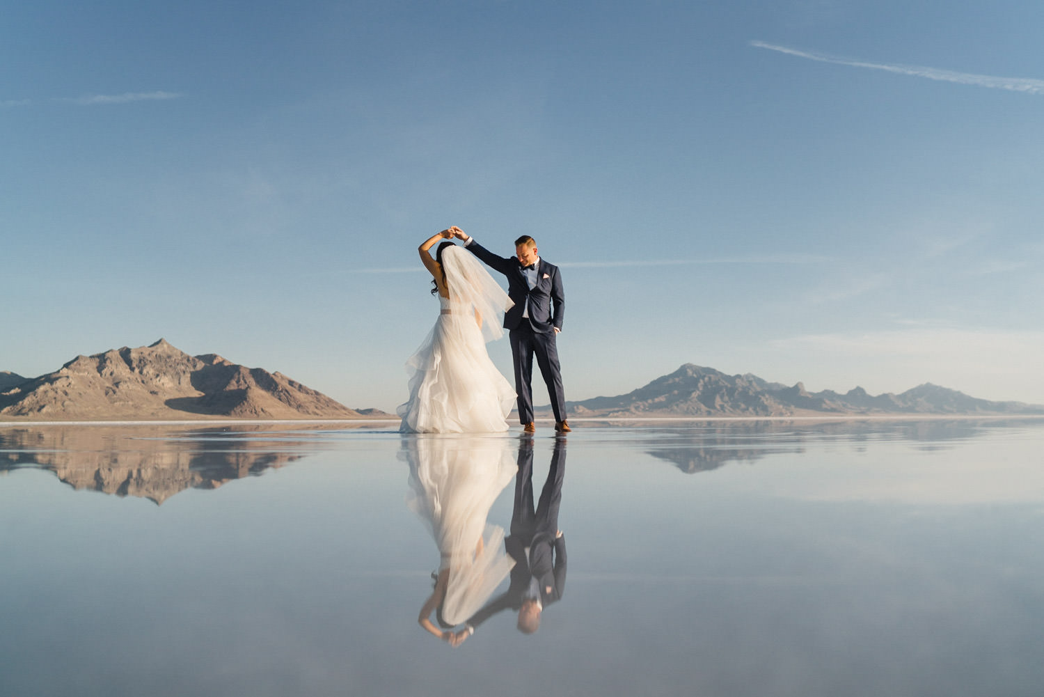 Bonneville Salt Flats wedding bride and groom dancing with reflection photo