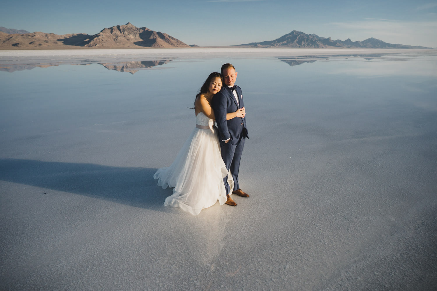 Bonneville Salt Flats wedding bride hugging groom photo